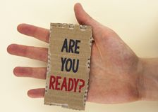 Conceptual hand writing showing Are You Ready Question. Business photo text Prepare well to face upcoming business changes written. Tear Cardboard Piece the Royalty Free Stock Image