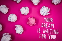 Conceptual hand writing showing Your Dream Is Waiting For You. Business photo text Goal Objective Intention Target Yearning Plan I. Deas pink background crumpled stock photography