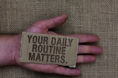 Conceptual hand writing showing Your Daily Routine Matters. Business photo text Have good habits to live a healthy life Cardboard. With marked some letters on royalty free stock images