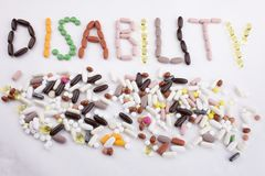 Conceptual Hand writing text caption inspiration Medical care Health concept written with pills drugs capsule word disability On w. Hite  background with space Stock Images