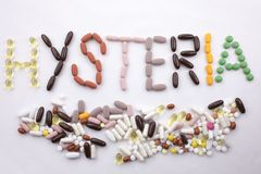 Conceptual Hand writing text caption inspiration Medical care Health concept written with pills drugs capsule word HYSTERIA season Stock Image