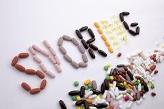 Conceptual Hand writing text caption inspiration Medical care Health concept written with pills drugs capsule word SNORIGN season Stock Photo