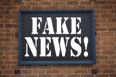 Conceptual hand writing text caption inspiration showing announcement Fake News. Business concept for Propaganda Newspaper Fake Ne. Ws written on frame old brick Royalty Free Stock Photo