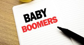 Conceptual hand writing text caption inspiration showing Baby Boomers. Business concept for Demographic Generation written on note. Book with space on book Royalty Free Stock Photography