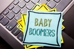 Conceptual hand writing text caption inspiration showing Baby Boomers. Business concept for Demographic Generation written on stic. Ky note paper on dark Royalty Free Stock Photos