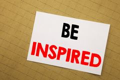 Conceptual hand writing text caption inspiration showing Be Inspired. Business concept for Inspiration and Motivation Written on s. Ticky note yellow background Stock Images