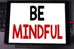 Conceptual hand writing text caption inspiration showing Be Mindful. Business concept for Mindfulness Healthy Spirit written on ta. Blet laptop on black keyboard Royalty Free Stock Image
