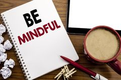 Conceptual hand writing text caption inspiration showing Be Mindful. Business concept for Mindfulness Healthy Spirit written on no. Tepad paper on the wood table Royalty Free Stock Photography