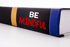 Conceptual hand writing text caption inspiration showing Be Mindful. Business concept for Mindfulness Healthy Spirit written on th. E book the white background Stock Photography