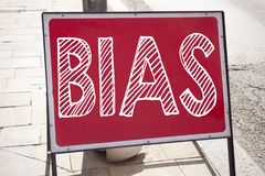 Conceptual hand writing text caption inspiration showing Bias. Business concept for Prejudice Biased Unfair Treatment written on a. Nnouncement road sign with Stock Photo