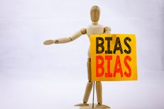 Conceptual hand writing text caption inspiration showing Bias Business concept for Prejudice Biased Unfair Treatment written on st. Icky note sculpture Stock Image