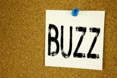 Conceptual hand writing text caption inspiration showing Buzz. Business concept for Buzz Word llustration written on sticky note,. Reminder cork background with stock images