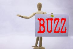 Conceptual hand writing text caption inspiration showing Buzz Business concept for Buzz Word llustration written on sticky note sc. Ulpture background Stock Photography
