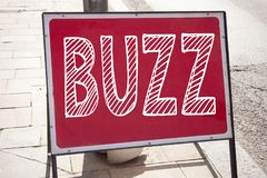 Conceptual hand writing text caption inspiration showing Buzz. Business concept for Buzz Word llustration written on announcement. Road sign with background and royalty free stock images