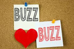 Conceptual hand writing text caption inspiration showing Buzz concept for Buzz Word llustration and Love written on sticky note, r. Eminder cork background with royalty free stock image