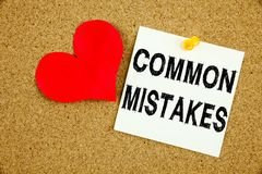 Conceptual hand writing text caption inspiration showing Common Mistakes concept for Common Decision Mistakes and Love written on. Sticky note, reminder cork Stock Images