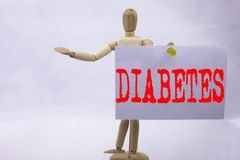 Conceptual hand writing text caption inspiration showing Diabetes Business concept for Disease Medical Insulin written on sticky n. Ote sculpture background Stock Photography