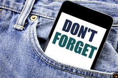 Conceptual hand writing text caption inspiration showing Do Not Forget. Business concept for Don t memory Remider Written phone mo. Bile phone, cellphone placed Stock Photo