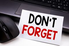 Conceptual hand writing text caption inspiration showing Do Not Forget. Business concept for Don t memory Remider written on stick. Y note paper on black Stock Image