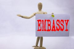 Conceptual hand writing text caption inspiration showing Embassy Business concept for Tourist Visa Application written on sticky n. Ote sculpture background Stock Photography