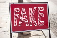 Conceptual hand writing text caption inspiration showing Fake News. Business concept for Fake News written on announcement road si. Gn with background and space Stock Image
