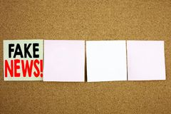 Conceptual hand writing text caption inspiration showing Fake News Business concept for Propaganda Newspaper Fake News on the colo. Urful Sticky Note close-up Royalty Free Stock Photos