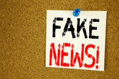 Conceptual hand writing text caption inspiration showing Fake News. Business concept for Propaganda Newspaper Fake News written on. Sticky note, reminder cork Royalty Free Stock Photography
