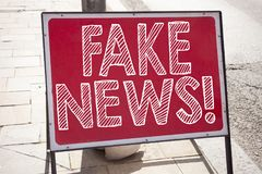 Conceptual hand writing text caption inspiration showing Fake News. Business concept for Propaganda Newspaper Fake News written on Stock Photo