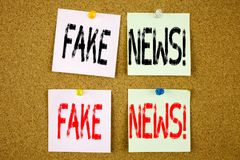 Conceptual hand writing text caption inspiration showing Fake News concept for Propaganda Newspaper Fake News and Love written on. Wooden background, reminder Royalty Free Stock Image