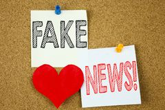 Conceptual hand writing text caption inspiration showing Fake News concept for Propaganda Newspaper Fake News and Love written on. Sticky note, reminder cork Royalty Free Stock Image