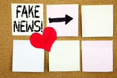 Conceptual hand writing text caption inspiration showing Fake News concept for Propaganda Newspaper Fake News and Love written on. Wooden background, reminder Stock Photos