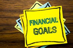 Conceptual hand writing text caption inspiration showing Financial Goals. Business concept for Income Money Plan written on sticky. Note paper on wooden wood Royalty Free Stock Photo