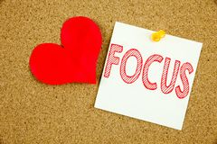 Conceptual hand writing text caption inspiration showing Focus concept for Attention Success Concentrate and Love written on stick. Y note, reminder cork Stock Image