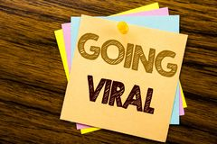 Conceptual hand writing text caption inspiration showing Going Viral. Business concept for Social Viral Business written on sticky. Note paper on wooden Stock Photos