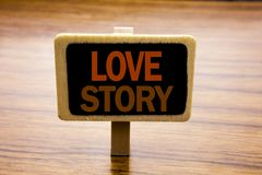 Conceptual hand writing text caption inspiration showing Love Story. Business concept for Loving Someone Heart  written on announc. Ement board on wooden wood Stock Images