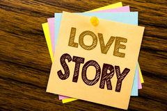 Conceptual hand writing text caption inspiration showing Love Story. Business concept for Loving Someone Heart  written on sticky. Note paper on wooden Royalty Free Stock Image