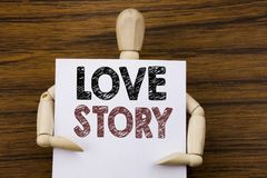 Conceptual hand writing text caption inspiration showing Love Story. Business concept for Loving Someone Heart  written on sticky. Note paper on wooden Royalty Free Stock Photography