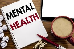 Conceptual hand writing text caption inspiration showing Mental Health. Business concept for Anxiety Illness Disorder written on n. Otepad paper on the wood stock images
