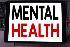 Conceptual hand writing text caption inspiration showing Mental Health. Business concept for Anxiety Illness Disorder written on t. Ablet laptop on black stock image