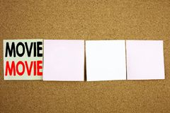 Conceptual hand writing text caption inspiration showing Movie Business concept for Entertainment Movie Film on the colourful Stic Stock Photo