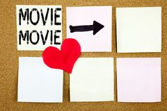 Conceptual hand writing text caption inspiration showing Movie concept for Entertainment Movie Film and Love written on wooden bac Royalty Free Stock Photography