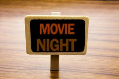 Conceptual hand writing text caption inspiration showing Movie Night. Business concept for Wathing Movies written on announcement. Board on wooden wood royalty free stock photography