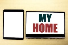 Conceptual hand writing text caption inspiration showing My Home. Business concept for House Estate Love written on tablet laptop. Conceptual hand writing text royalty free stock photos