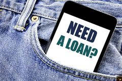 Conceptual hand writing text caption inspiration showing Need A Loan Question. Business concept for Mortage Credit Written phone m. Obile phone, cellphone placed Royalty Free Stock Photography