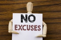Conceptual hand writing text caption inspiration showing No Excuses. Business concept for Stop Ban for Excuse written on sticky no. Te paper on wooden background Stock Image