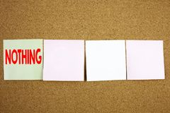 Conceptual hand writing text caption inspiration showing Nothing Business concept for Contradiction Nothing Rejection on the colou. Rful Sticky Note close-up Stock Photography