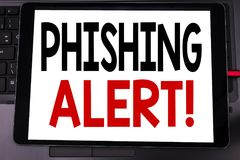 Conceptual hand writing text caption inspiration showing Phishing Alert. Business concept for Fraud Warning Danger written on tabl. Et laptop on black keyboard Stock Image