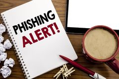Conceptual hand writing text caption inspiration showing Phishing Alert. Business concept for Fraud Warning Danger written on note. Pad paper on the wood table Royalty Free Stock Photos
