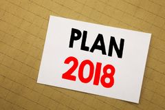 Conceptual hand writing text caption inspiration showing Plan 2018. Business concept for Planning Strategy Action Plan Written on. Sticky note yellow background Stock Photos