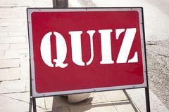 Conceptual hand writing text caption inspiration showing Quiz. Business concept for Test education Exam Concept written on announc. Ement road sign with royalty free stock photo